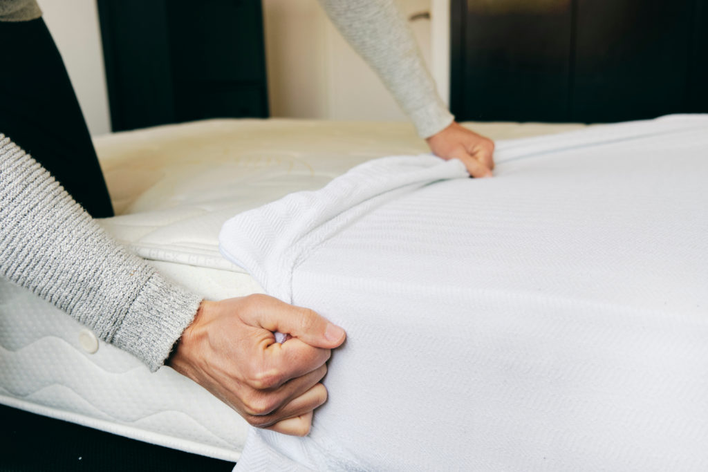 Mattress protector on bed representation image
